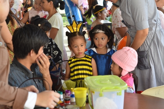 kids in line for face painting