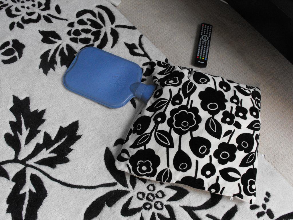 Hot Water Bottle + Blankets = Warm Feeling