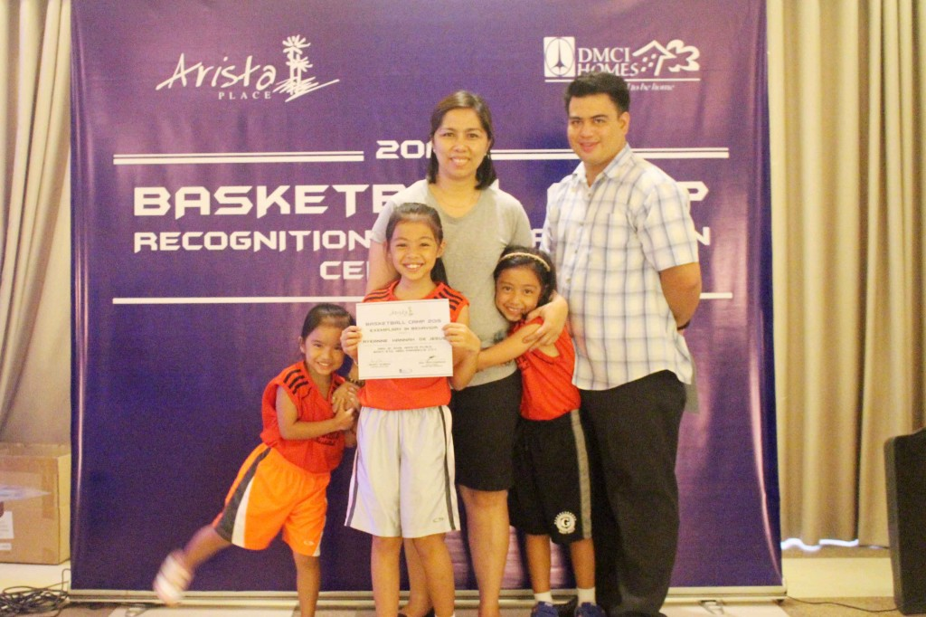 The families and happy faces of our campers receiving their certificates  of completion and special awards !