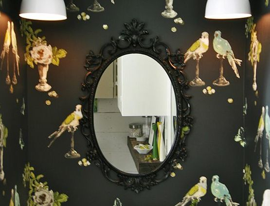 Oval mirrors and black wall
