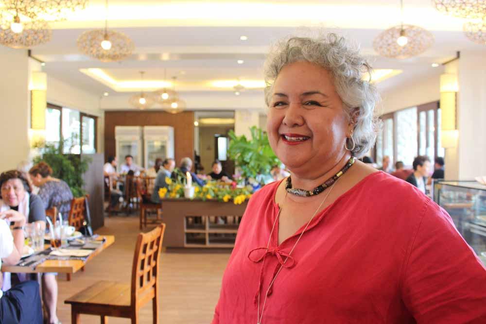 Mitos Benitez-Yñiguez welcomes customers of Cafe Adriana