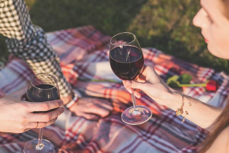 couple dating sharing glass of wine