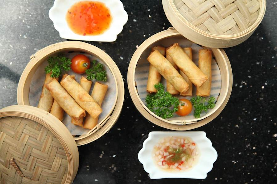 fried spring rolls served in bamboo steamer
