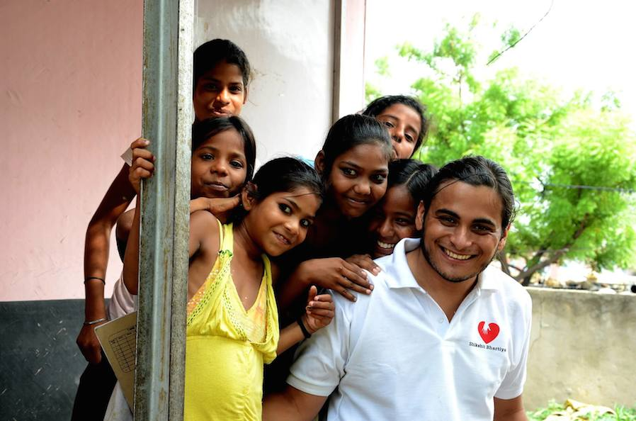 picture of a man working in a charity and kids