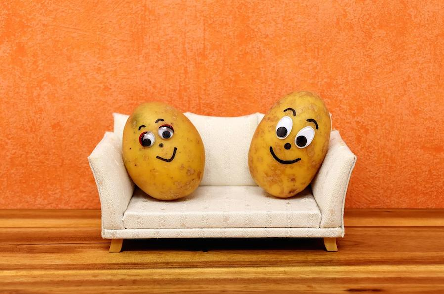 two potatoes placed on a miniature sofa