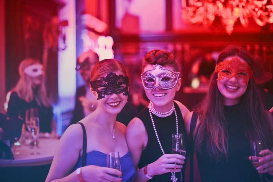 women friends in a mask night party