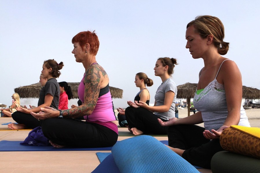 women in a outdoor yoga class