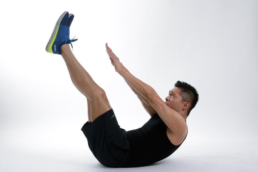 man reach toe taps position