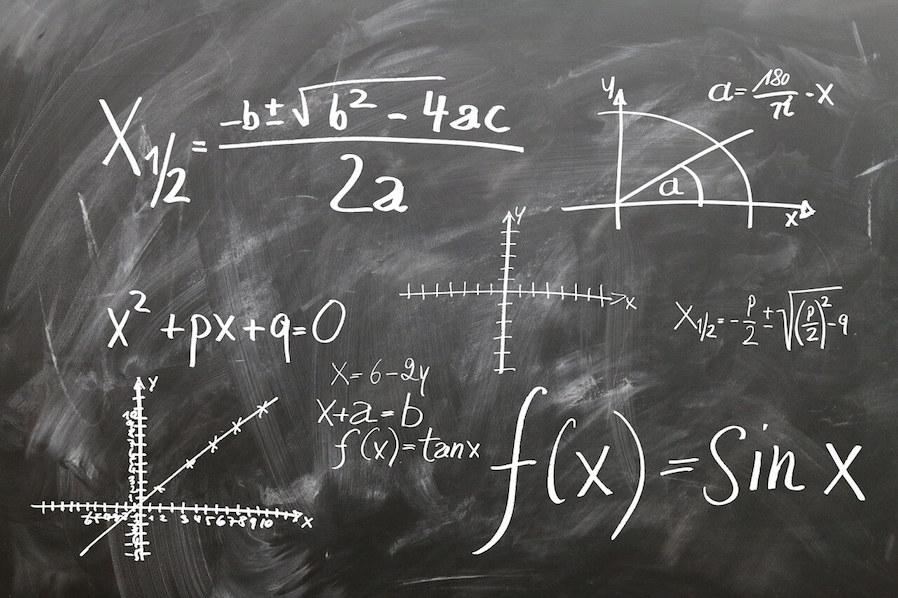 mathematics equation written in black board