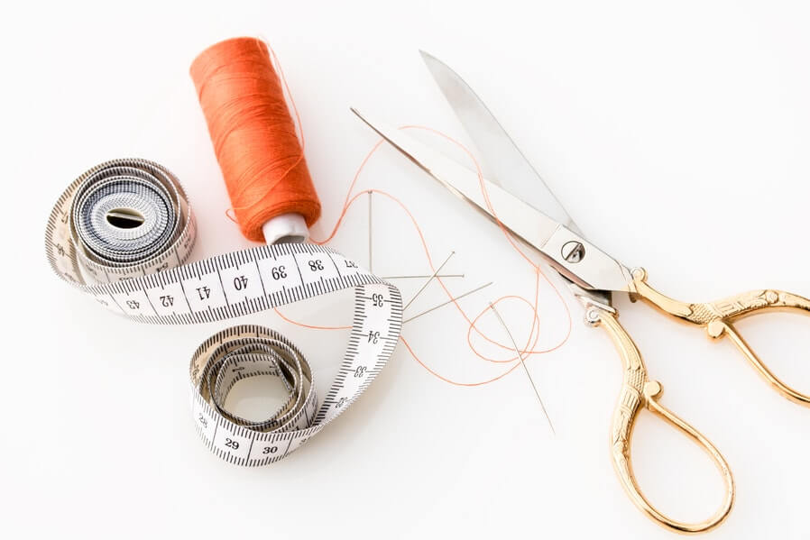 sewing kit thread, scissor, and tape measure