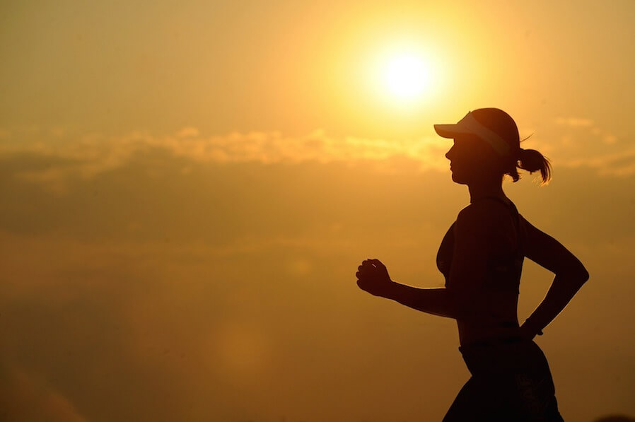 woman running during sunrise