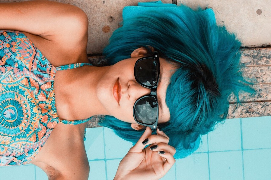 woman with blue hair posing for swimming picture