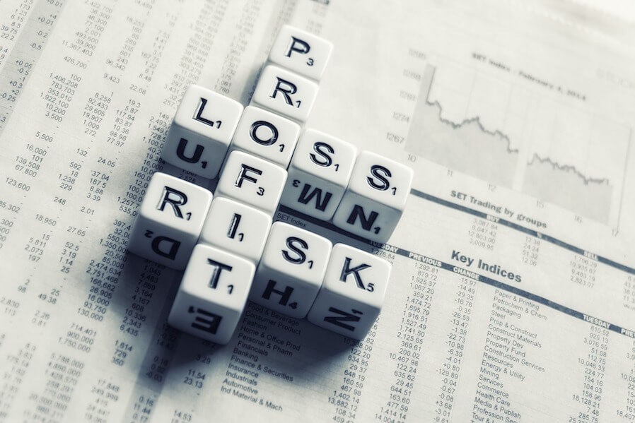 dices spelled profit, loss, and risk