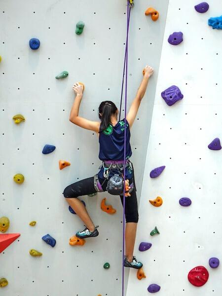 man brick climbing