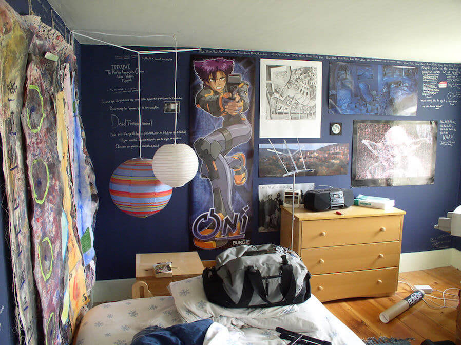 bedroom full of posters