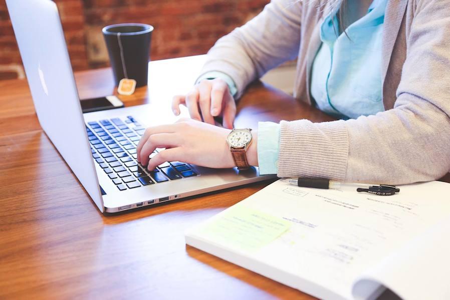 woman using laptop in coffee shop