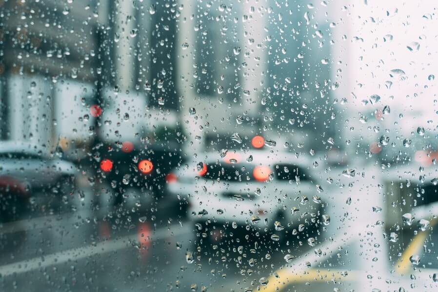 car window view of street during rain