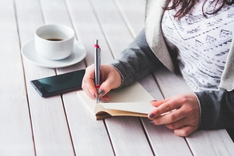 woman hand writing on a desk
