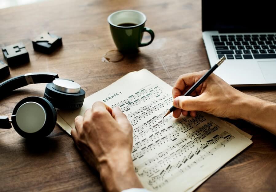 man composing a song