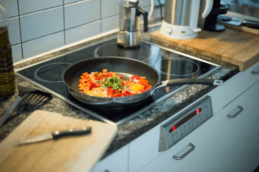 stir frying eggs and vegetables