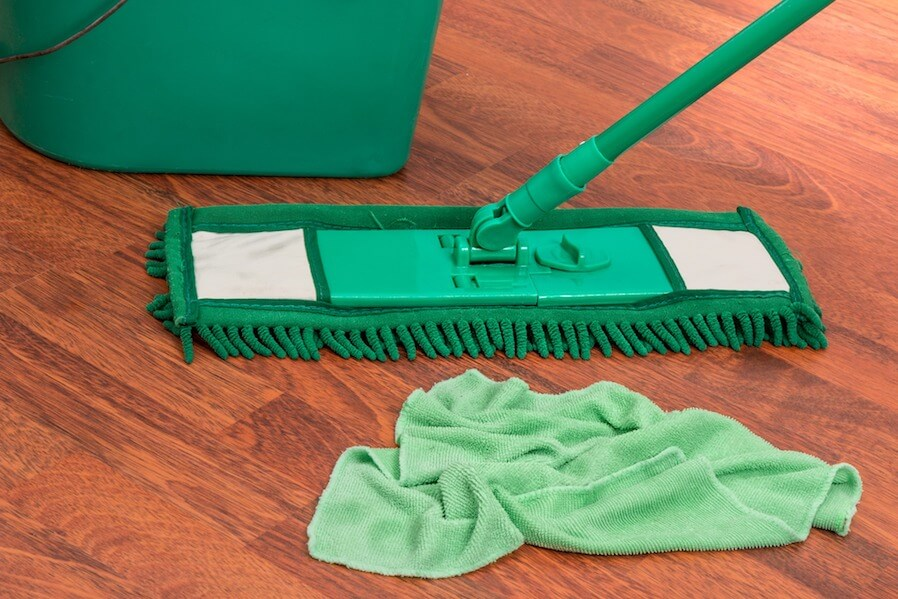 sweeping the floor using mop