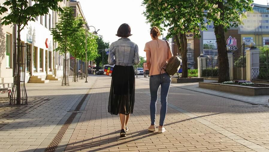 two friends walking outside