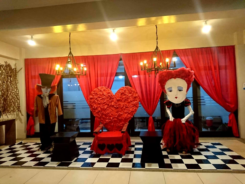 The Mad Hatter and the Queen of Hearts awaits your presence.