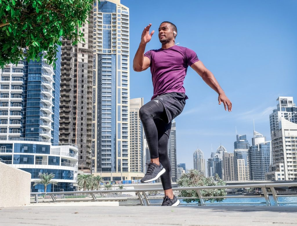 man jogging city