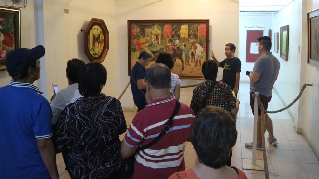 At the Blanco Family Museum, everyone was welcomed by a guide who was quick to explain the paintings hanging on the wall.