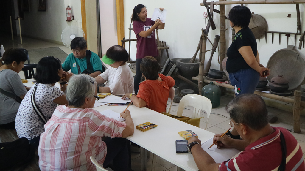 After the insightful tour, the elderlies engaged in a short art class where they are taught the basics of drawing especially colouring using oil pastels.