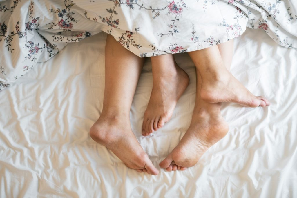 adults barefoot bed