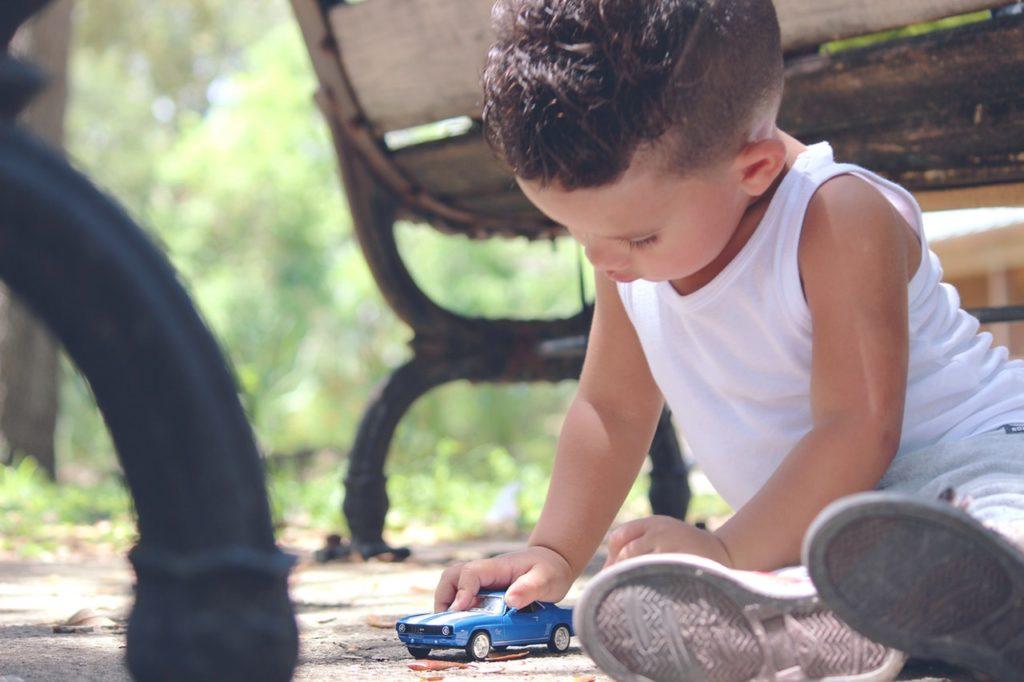 baby boy child playing car
