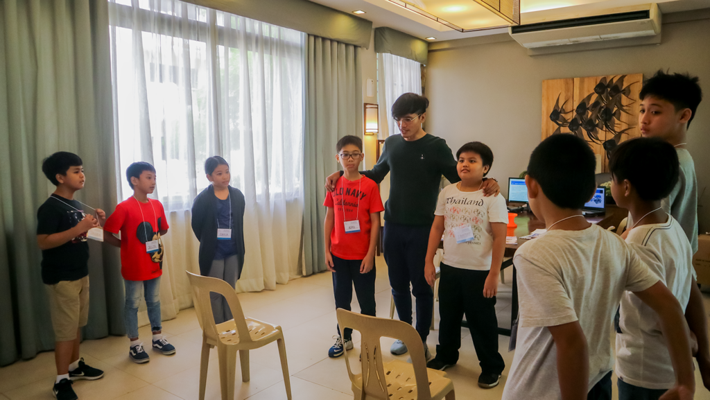 The kids paying close attention to the instructions of the activity. One of the main goals of the workshop is to promote camaraderie among the kids.