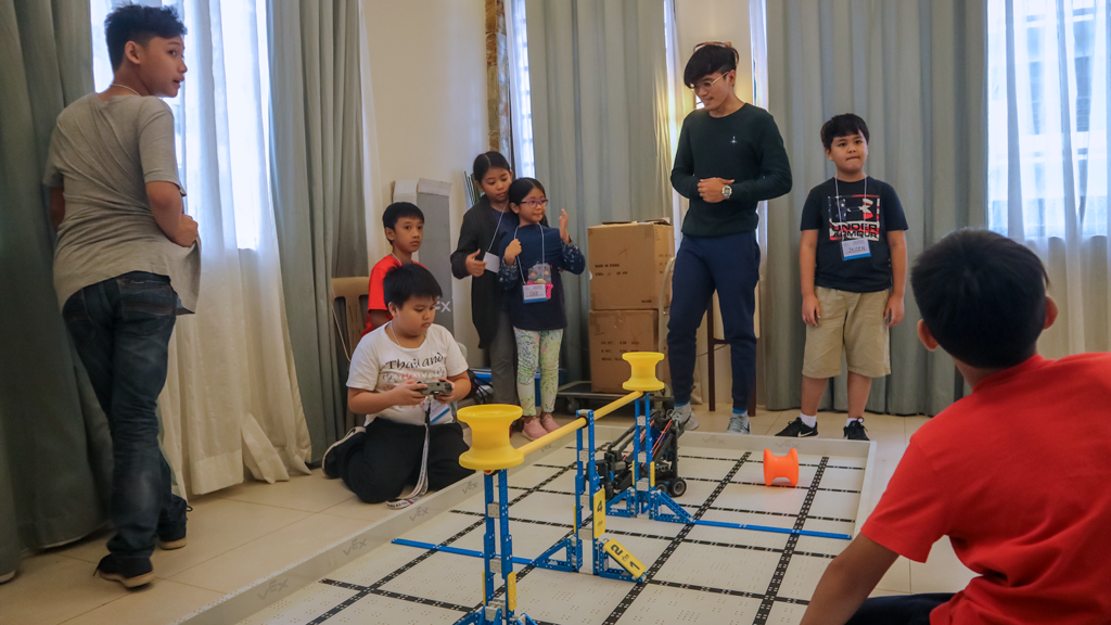 Robotics shouldn't be daunting: one of the kids is trying out the controls of the robot.
