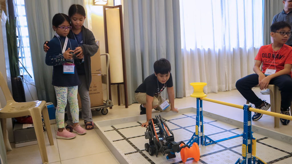 Sisters in control: you always have a helping hand in robotics.
