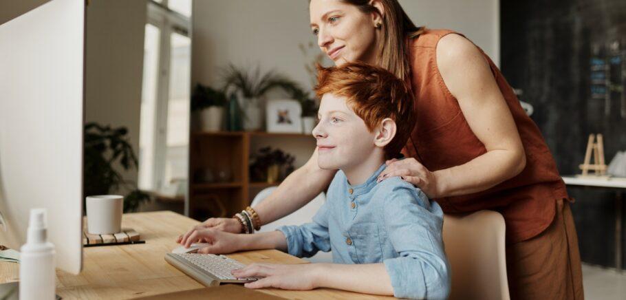 woman teaching his son