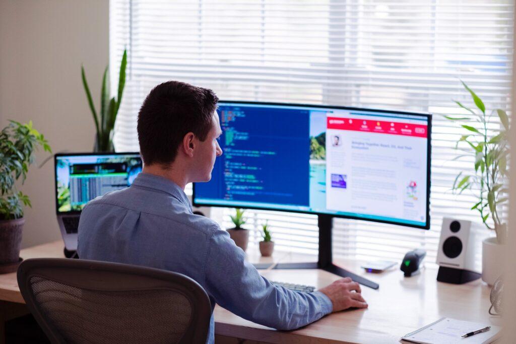 man facing desktop
